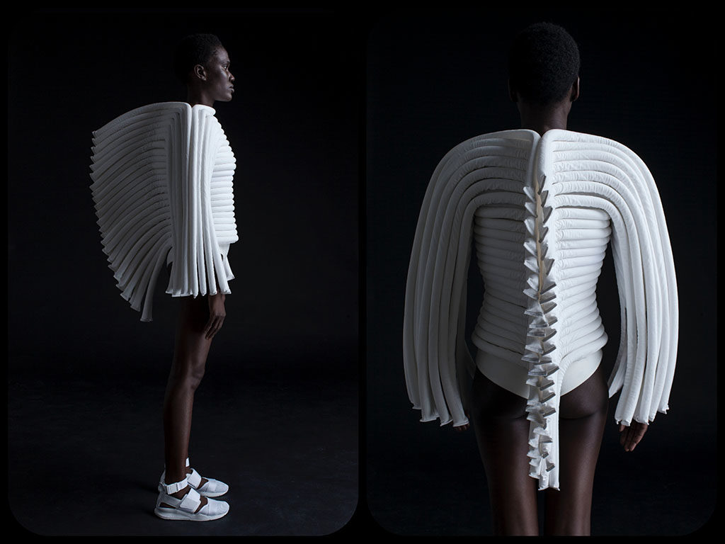 """15: Fashion: The """"CORPUS"""" collection - DZHUS The """"CORPUS"""" collection is dedicated to anatomy as the starting point for DZHUS' design. The architectonics of physicality as a triumph of function and synergy – this concept has incarnated in the complex transformable structures, resembling exoskeletons. As a material body is an exquisite mechanism, driven by the phenomenal life energy, the technological morphology of DZHUS clothing is inseparable with the one-of-a-kind essence of its possessor.Not only is the Autumn/Winter capsule saturated with rhythmical textures and distinctive pattern-making ideas, but it also meets high standards of ethical production. More info: DESIGNER: Irina Dzhus www.irinadzhus.com"""