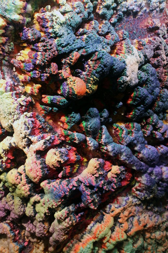 "4me4you visits Unit London Gallery which showcased Dylan Gebbia-Richards ""Kinesthesia"". Unit London Gallery…>artist Dylan Gebbia-Richards, brings insight into his transcendent works in which the organic is appropriated by the artificial. Kinesthesia, marks Gebbia-Richards' first solo-show with Unit London and in his words: ""Kinesthesia is ones sense of their body in space. It is because of kinesthesia that we can walk in a room which is completely dark. Kinesthesia is the sum of the useful sensory information about our body in motion. My art is visual but the mental information I use to create this work comes from a kinesthetic sense, or feeling, about the work, rather than a visual or analysis of it."" Gebbia-Richards' works become landscapes - organic protrusions that seem to escape from the canvas. The artist embarks on a discovery of the physical manifestations of his scientific background. His geological creations, reminiscent of the landscape in Gebbia-Richards' hometown, demand the space they inhabit in a similar way that agriculture might scale and dominate a building if left to its own devices."