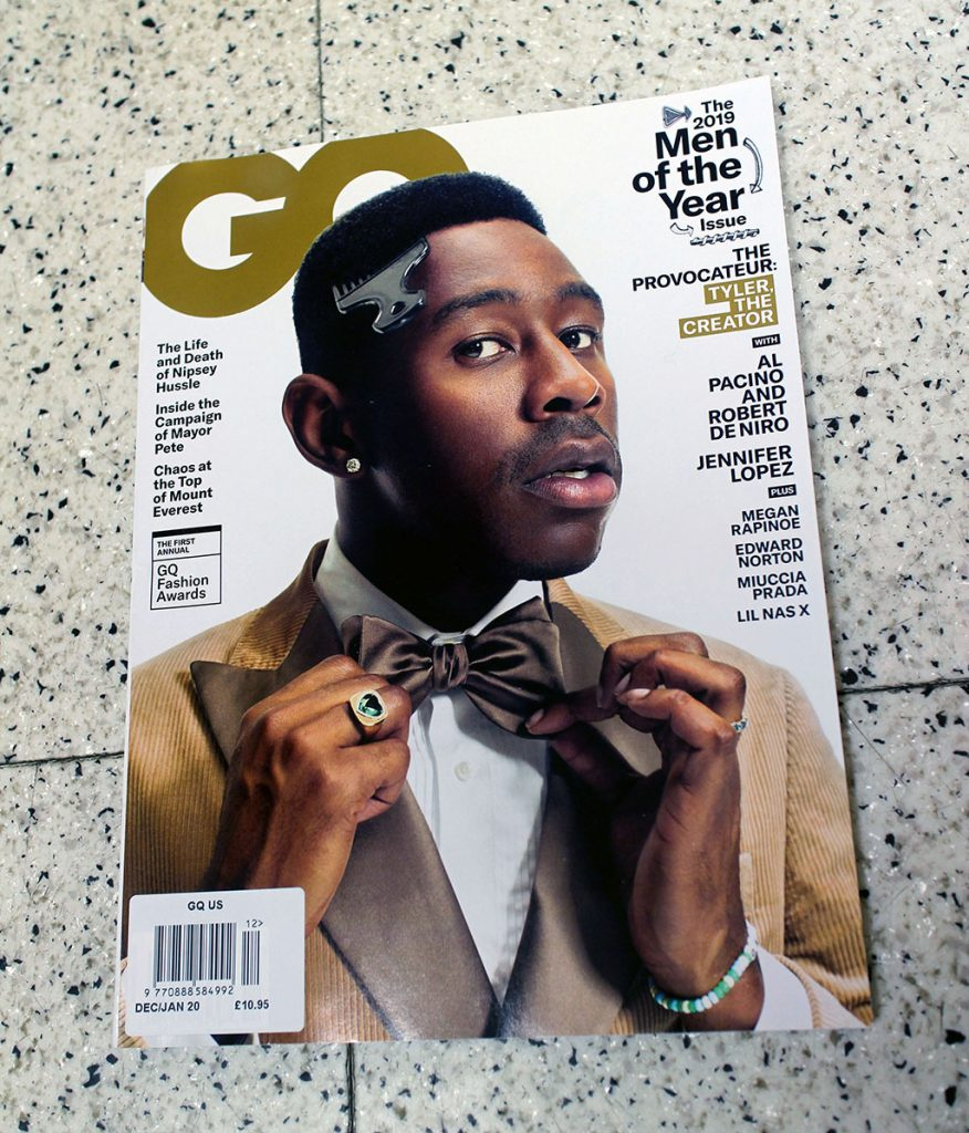 "IN ""Camden News"" store to see ""gq"" magazine"